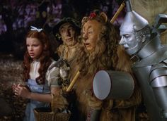 Still of Judy Garland, Ray Bolger, Jack Haley and Bert Lahr in The Wizard of Oz (1939)