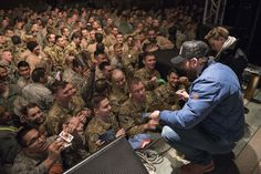 https://flic.kr/p/PHP6YE | 161205-D-PB383-039 | Scarlett Johansson and Chris Evans sign autographs for service members during the USO Holiday Tour at Incirlik Air Base, Dec. 5, 2016. Marine Gen. Joseph F. Dunford, Jr., chairman of the Joint Chiefs of Staff, and USO entertainers, will visit service members who are deployed from home during the holidays at various locations across the globe. This year's entertainers included actor Chris Evans, actress Scarlett Johansson, NBA Legend Ray Allen…