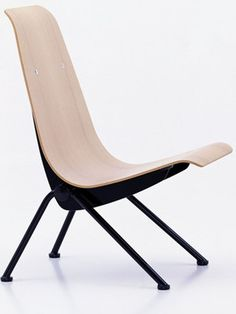 Oak Antony chair by Jean Prouve from the Vitra collection. The Antony chair was designed in the early 1950's for the Cite Universitaire at Antony near Paris and is one of Jean Prouve's last pieces of furniture design.
