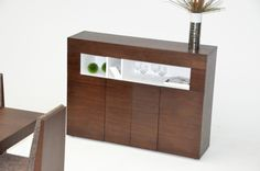 This is a beautiful Modern Dining Buffet which features an elegant tobacco finish. Four door access to your dining accessories, and separated storage slot for convenience. With it's unique contrast design, it will surely be the center of attention.