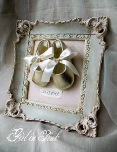Thrift store framed print turned nursery art with a little Chalk Paint® Decorative Paint by Annie Sloan and a pair of cute little shoes.