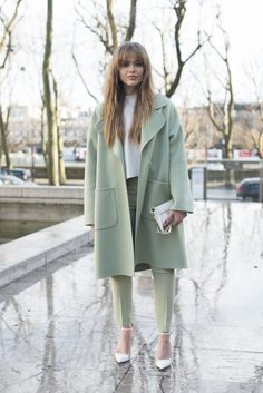 A soft head-to-toe palette: a sleek coat, sharp trousers, pumps, and a matching clutch