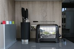 Boralino oak above grey granite worktop with knife block and toaster in our modern high gloss kitchen with a rustic twist. Modern Rustic, Modern Contemporary, Grey Gloss Kitchen, Wood Veneer, Toaster, Knife Block, Granite, Kitchen Appliances, Woodworking