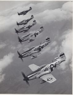 US 8th Air Force P-51 Mustang fighters with droptanks.