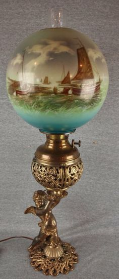 Bradley & Hubbard brass cherub banquet lamp with ship