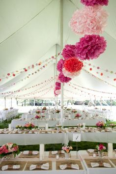 Tent decor: Whimsical, romantic. Paper banners, pink, magenta, light pink pomanders...