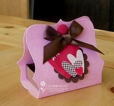"""Give your treat box a makeover with this """"pretty in pink"""" holder. For delicious treats and sweets recipes for Valentine's Day, check out http://www.simplycreate.com/."""