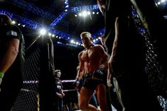 Conor McGregor leaves the cage after defeating Marcus Brimage. (Getty)