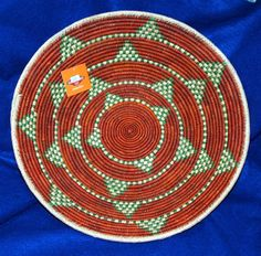 "A beautiful, finely woven basket.  14.5"" in diameter with a 3"" depth.  Similar in quality to those woven by the Navajo of the SW. $24.95 #basket #handwoven #southwestern #homedecor"