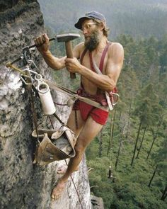Old school rock climbing. Sketching rock climber with old gear.