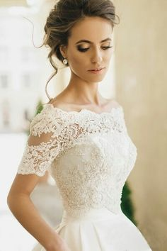 WOW. This wedding dress with lace sleeves is lovely.