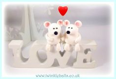 MICE IN LOVE Two handmade polymer clay mice holding a glass heart balloon, sat upon a wooden free standing 'LOVE' sign.  www.twinkleballs.co.uk