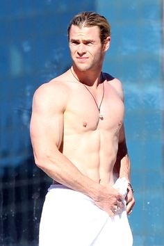 Heartthrob Chris Hemsworth shows off his ripped body as he chills by his hotel pool on June 18, 2012.