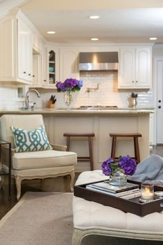 HGTV showcases a neutral traditional living room adjacent to a small kitchen with an open floor plan and serious style.                                                                                                                                                                                 More