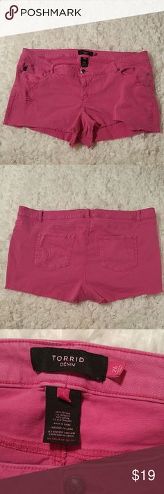 "Torrid Distressed Jean Shorts in Hot Pink Very cute cutoff short shorts in hot pink denim. Intentional distressing and fraying. Measures approximately 12"" from waist to hem (16"" in back). Light fading, but excellent condition. Size 26. Cotton spandex blend, so stretchy. Perfect for summer! torrid Shorts Jean Shorts"