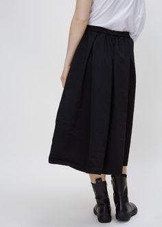 Elastic waist drawstring skirt. Side seam pockets. Dry clean.