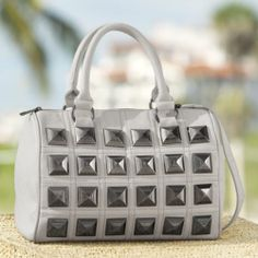 Square Pyramid Stud Bag from Monroe and Main. Catch the light and corral your things, too!