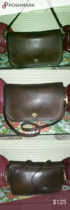 """COACH RARE""""MADE IN N.Y CITY"""" BAG CHOCOLATE BROWN COACh,Chocolate brown Beauty, gorgeous Rare 1970's to 1980's bag made in NYC. Has the words leatherware under word coach making it one of Coachs very early bags when they were still being made in a loft in NYC! THIS VTG BEAUTY has no wear on her piping and no damage, marks nor stains!! So well kept by her owner after all these years...anywhere from 36 years old or older!!! She is just Amazing! Look at her shine, thats how Coach bags are…"""