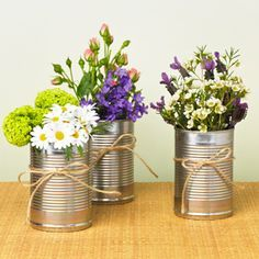 Tin can vases. Lady at the farmers market was selling wildlowers in these and I wanted to buy them all for your wedding but I didn't think they'd keep very well. http://ourfarmjourney.com/maine-farmers-markets/