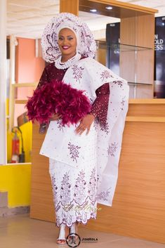 bride Victory wears Aso Oke and holds a feathered fan, as she becomes a Yoruba Wife Nigerian Wedding Dresses Traditional, Traditional Wedding Attire, African Traditional Wedding, African Traditional Dresses, African Wedding Attire, African Attire, African Dress, African Wear, Nigerian Bride