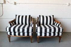 Striped pair of armchairs. How could you not feel like a queen in one of these?! Love the graphic print on the classic profile of the chair.