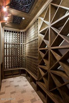 Love the wine cellar, but check out the ceiling tile design in the roof.