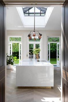 House tour: the London family home with a hidden pool - kitchen lights . - House tour: the London family at home with a hidden pool – kitchen lighting - Vogue Living, Hidden Pool, Hidden House, Home Modern, Modern French Interiors, London House, London Townhouse, Vogue Australia, Cuisines Design
