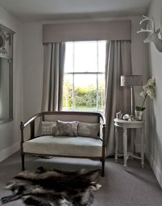 Grey Country Hallway with Antique Sofa and Hide Rug
