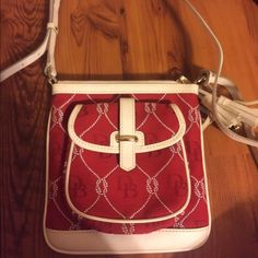 Red & White Dooney&Bourke Crossbody with wristlet. No signs of wear and tear Dooney & Bourke Bags Crossbody Bags