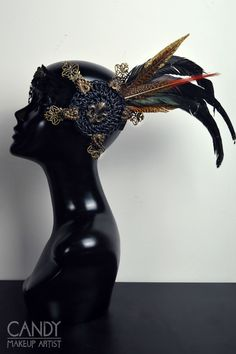 An handmade very light weight headdress. Ideal for parties, festivals and events or if you want to wear it all day long. The decoration is on the left side of the head It's decorated with several handmade ornaments, feathers, lace, rhinestones and many more small details The headdress is made with an elastic band on the back for a good fit.  100% handmade