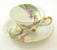 vintage demitasse cup and saucer set; three footed.   http://www.lady-of-the-lake.com/vintage-teacups-2.html