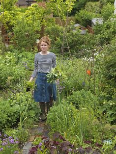 Alys Fowler, picks mint in her 18m x 6m back garden where she grows an amazing mixture of fruit, herbs, decorative and edible flowers and vegetables in packed borders. Aspirational gardening!