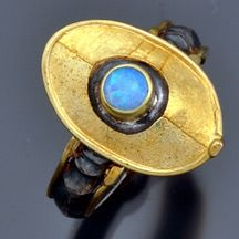 David and Nissa Vrooman: 18k Gold Sterling Window Rings