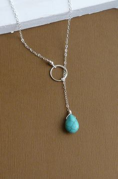 Sterling Silver Eternity Circle with Turquoise Stone -- Sterling Silver Lariat Necklace. $26.00, via Etsy.