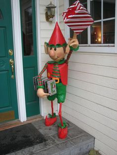 """""""After years of Christmas plywood cutout characters, we decided to follow the 3D trend and build some happy elves for our yard this year. The elves are wooden skeletons with newspaper pressed and taped all around to form the shapes. Two coats of paper mache, bits of clay added, gesso, paint, and waterproofing and they are ready for display!"""""""
