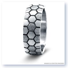 Inspired by the world�s most popular sport this sterling silver mens� soccer themed ring offers a beautiful honey-comb pattern reminiscent of a classic soccer ball surface. Fans of the beautiful game can wear it as a wedding band or fashion statement.