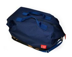 MADE IN AMERICA The Marine Traveler Bag has classic styling with rugged, functional, water resistant nylon canvas outer shell. Features metal hardware, interior