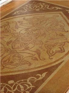 アースカラーの床ロゴと詳細Riverbedのコンクリートベルネ、テキサス州