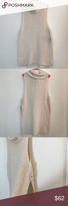 Free People sleeveless sweater. Free People sleeveless sweater with slits on the side. Cream colored with a beautiful cowl neck! Free People Sweaters Cowl & Turtlenecks