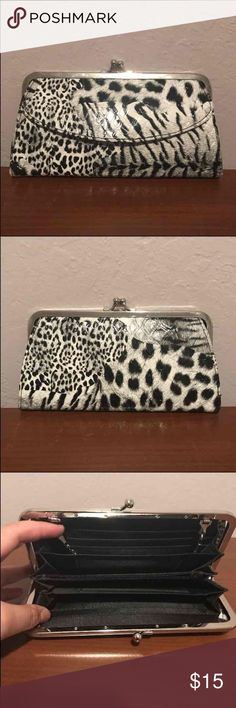 Black and white animal print wallet 9 billfold compartments, zippered coin purse, 2 transparent card slots, front pocket with flap, snap closure. Can be worn clutch style, shoulder bag style, or cross body style. Bags Wallets