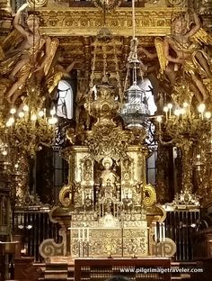 A close up of the gilded altar and the silver botafumerio in the cathedral of Santiago de Compostela, Spain.