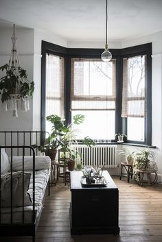 Today's bay window are anything but traditional. If you're thinking about adding them to your home, here are some contemporary bay window ideas. My Living Room, Home And Living, Living Spaces, Living Room With Bay Window, Bay Window Bedroom, Window Wall, Black Window Frames, Painted Window Frames, Window Design