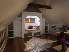 The home's former attic space is converted to a recreation area, where movies, games and lively conversation go hand in hand.