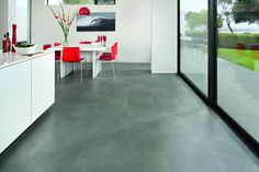 The slate-grey tones of Nisida give it an industrial edge that's perfect for contemporary styling. In a large square tile format, it provides a neat underfoot base on which to build a contemporary interior look. Vinyl Flooring, Kitchen Flooring, Kitchen Vinyl, The Slate, Grey Stone, Contemporary Interior, Sim, Tile Floor, Kitchen Ideas