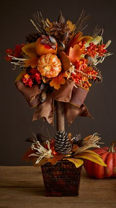 Looking for fall decor? Our interior designer has worked long hours gathering the best in fall home decor and decorating ideas. Harvest Decorations, Thanksgiving Decorations, Seasonal Decor, Fall Topiaries, Topiary Centerpieces, Fall Floral Arrangements, Autumn Decorating, Fall Home Decor, Fall Wreaths