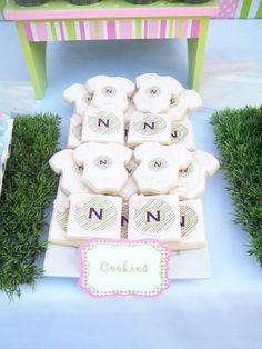 The Candy Buffet Company Montreal  pink, green frog themed candy buffet and baby shower, onesie cookies   baby shower decor, umbrellas, custom baby food jar labels.