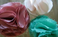 Tutorial for fluffy fabric flowers.  I've seen two ladies use these to cover clutches and they looked amazing!