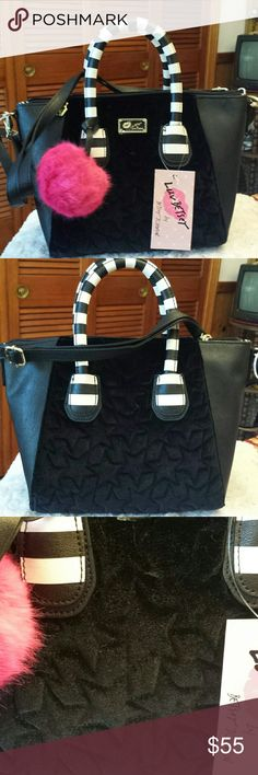 Betsy Johnson NWT Black Velvet Star Bag Betsy Johnson NWT Black and White Satchel, Faux Velvet Star pattern, Zippered Closure, Zippered pocket inside and 2 Slip pockets inside, Detachable shoulder strap, check dimensions it looks larger than it is Betsy Johnson Bags Satchels