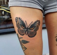 Owl-esque butterfly tattoo by Chris Stockings