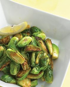 caramelized brussels sprouts with lemon; lemony brussels sprouts make an easy side dish that's pleasantly surprising; from Martha Stewart Vegetable Sides, Side Dishes Easy, Vegetable Side Dishes, Side Dish Recipes, Vegetable Recipes, Dishes Recipes, Caramelized Brussel Sprouts, Shredded Brussel Sprouts, Brussels Sprouts